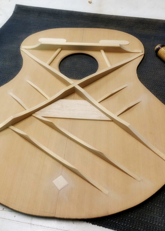a scalloped x-brace top