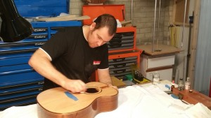 French polishing a beautiful Sitka spruce top with Tasmanian blackwood back and sides
